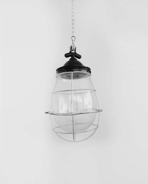 Caged glass light